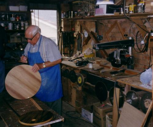 2000 PDG Werner Pohl wood crafting items for the Club, in his garage
